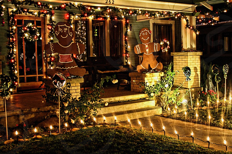 House decorated with holiday lights and gingerbread men photo