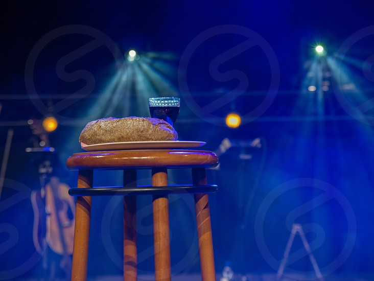 table in a church with holy supper bread and wine the body of christ photo