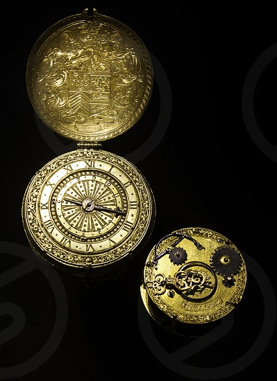Antique gold watch on a black background. photo