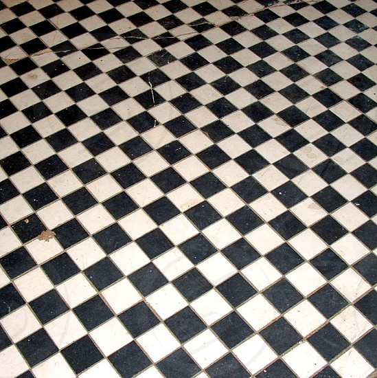 Black and white checkered floor shot on angle photo