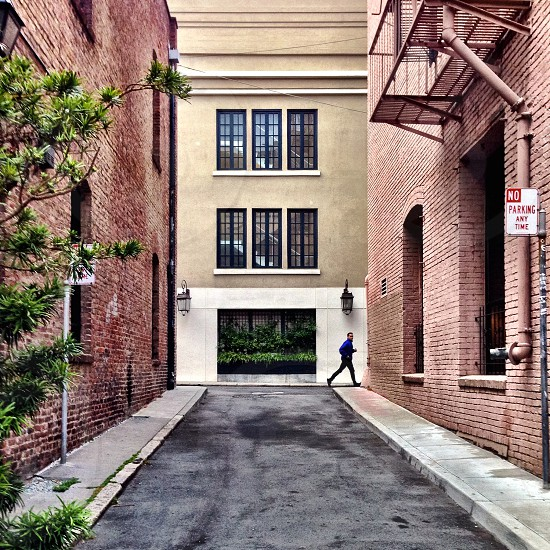 Urban street with solitary figure photo