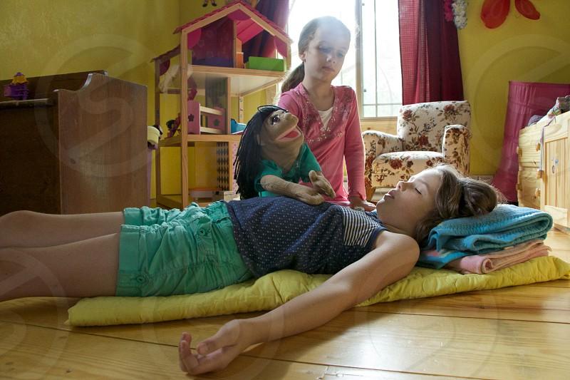 girl lying on the floor photo