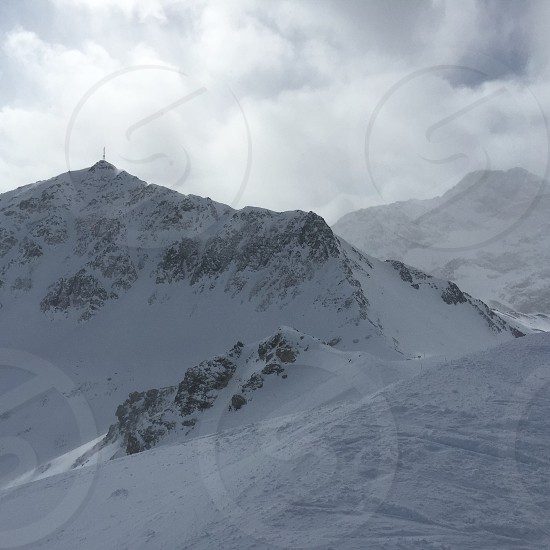mountain alps under white skies during daytime photo