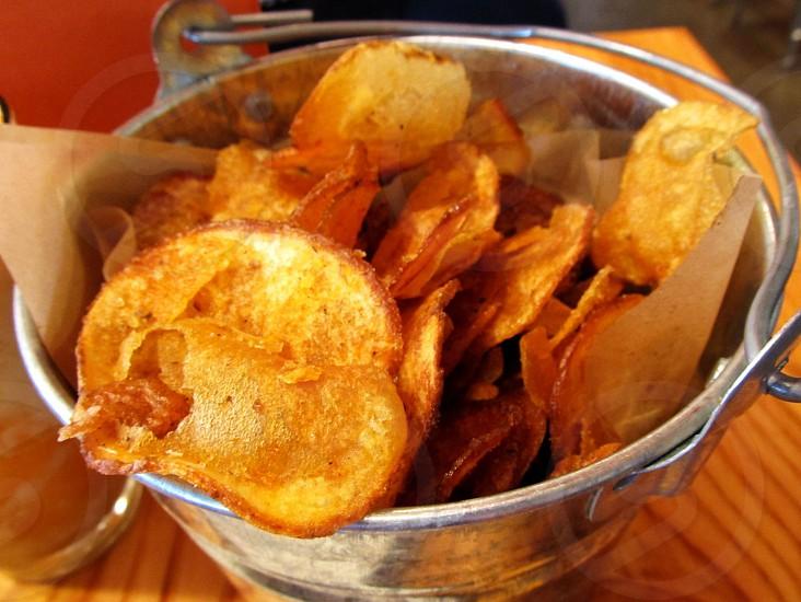 Potato chips in bucket photo