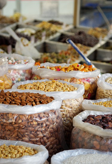 Nuts and seeds open baskets on a market stall. Fresh food. photo