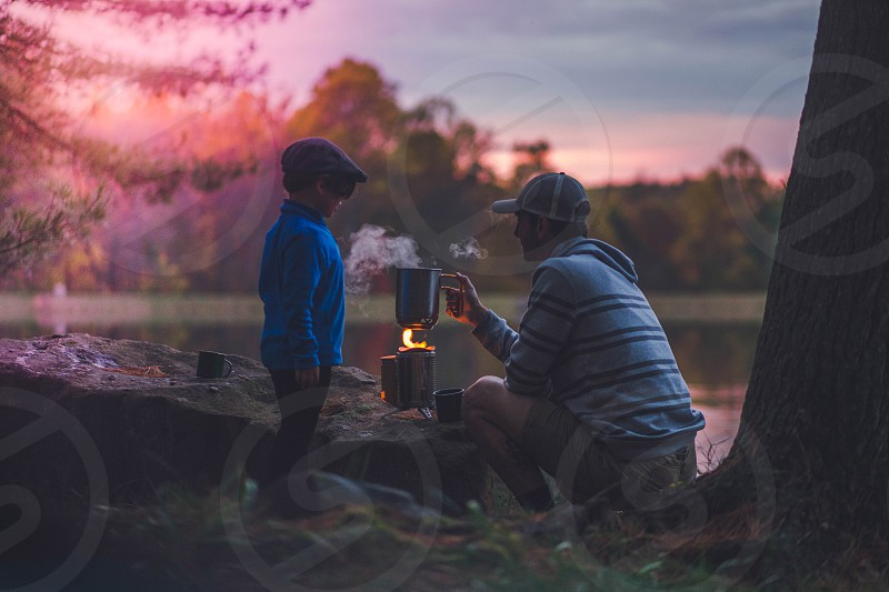camping nature cooking adventure hiking father and sun sunset photo