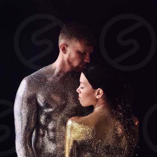 portrait of couple covered in glitter photo