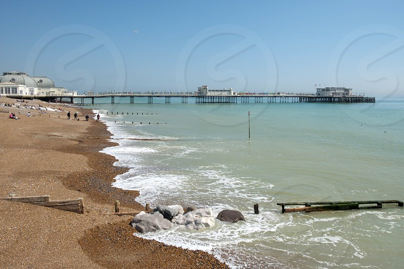 WORTHING WEST SUSSEX/UK - APRIL 20 : View of Worthing Pier in West Sussex on April 20 2018. Unidentified people photo