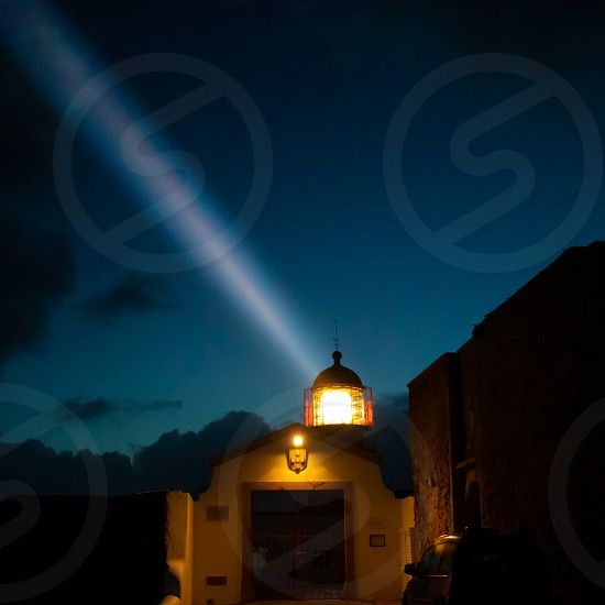 View of the lighthouse and cliffs at Cape St. Vincent in Portugal at night. The most south-western point of Europe. photo