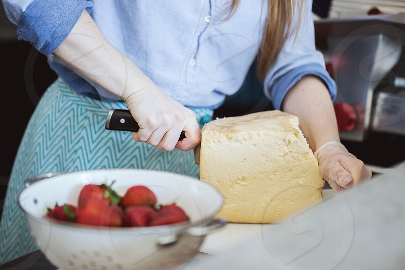 woman in blue button up long sleeved shirt holding a knife photo