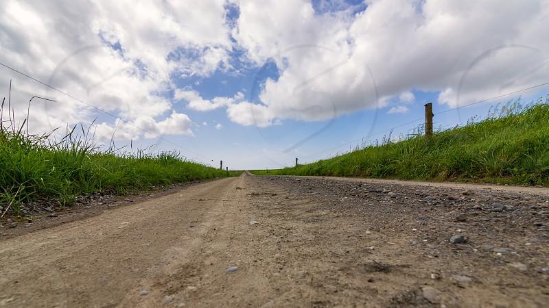 A dirt road along farmland in Northern California. photo