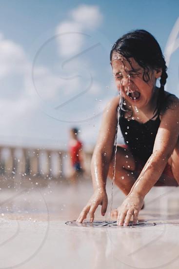 macro shot photopraghy of a girl taking a bath photo