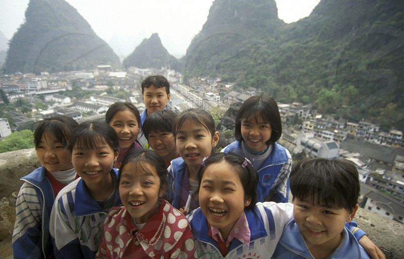 childern at a viewpoint in the landscape at the Li River near Yangshou near the city of  Guilin in the Province of Guangxi in china in east asia.  photo