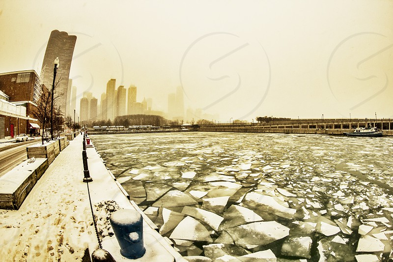 Broken ice on the water in a city photo
