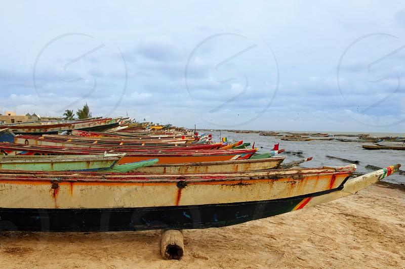 Africa Senegal Atlantic coast fishermen boats in a row photo