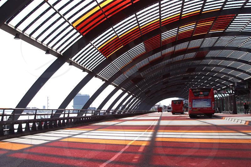 red bus on concrete bridge photo