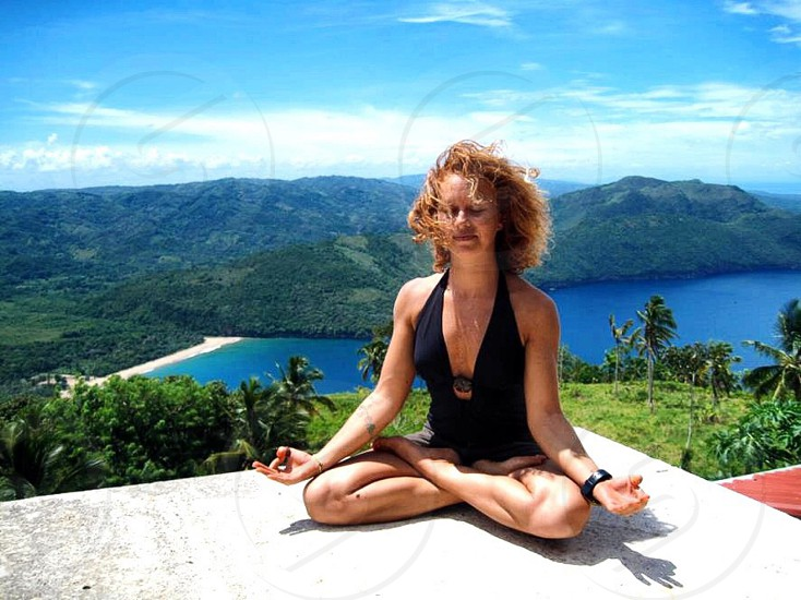 woman in black one piece swimsuit meditating photo