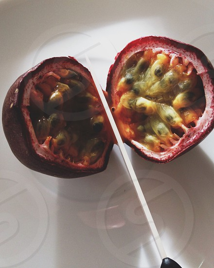 Cutting a passion fruit photo