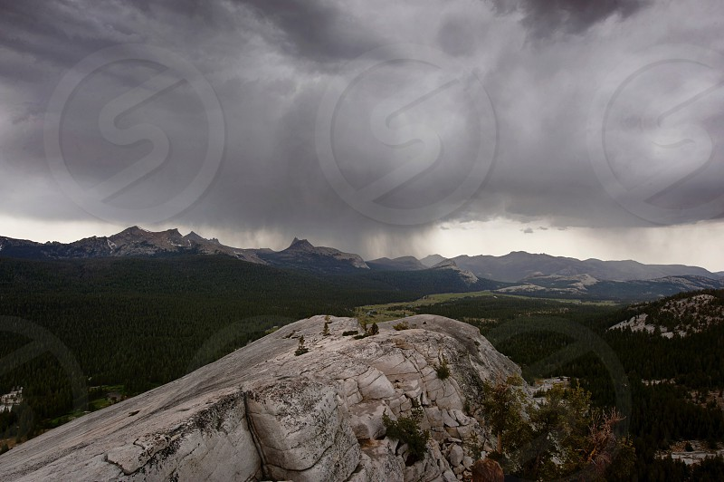 view of rocky mountain and thick clouds photo