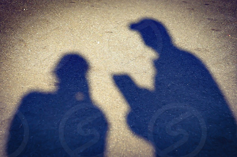 silhouette photography of two standing person photo