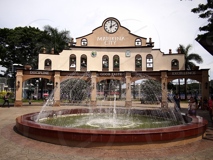 Public park with water fountain in the town center of Marikina City Philippines. photo