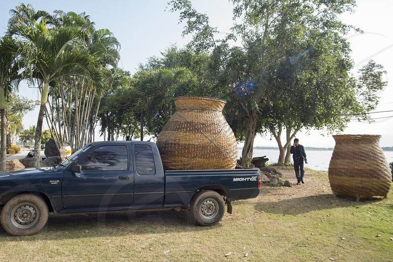 a transport with a big pot at the lake of Kwan Phayao in the city of Phayao in North Thailand. photo
