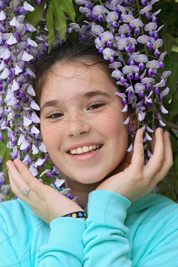 Portrait of a smiling teenage girl in flowers. photo