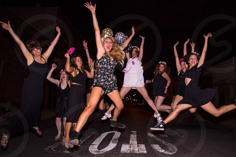 Bunch of fun girls jumping photo