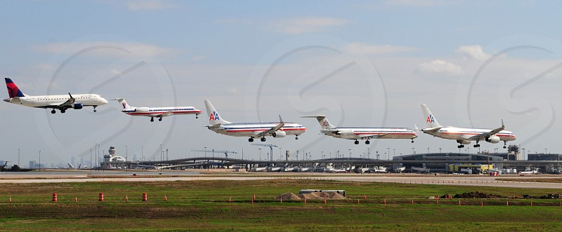 AIRPORT FLYING JETS LANDING MULTIPLE PLANES photo