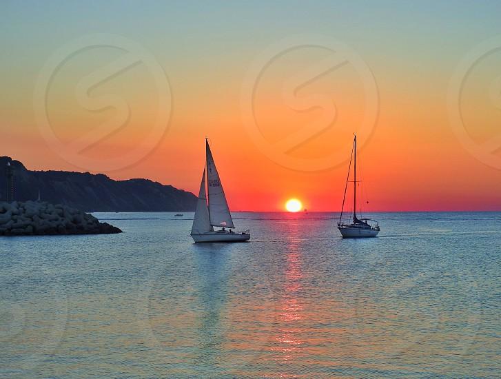 Boat sea sunset sun sky  photo