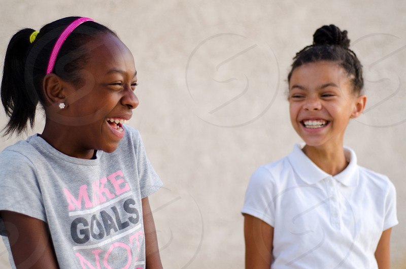 African American children girls laughing happy joy joyful smiling toothy smile friends friendship bestie best friend photo