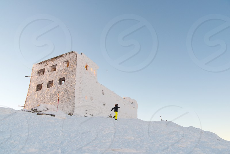 Buildings on the top of Pip Ivan mountain during winter sunrise photo