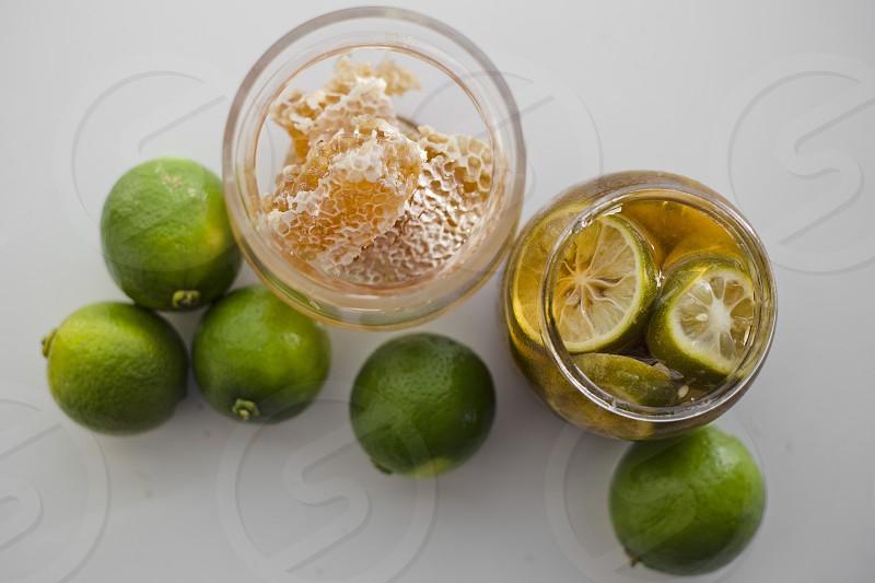 Green lemon and organic fresh honey Studio shot photo