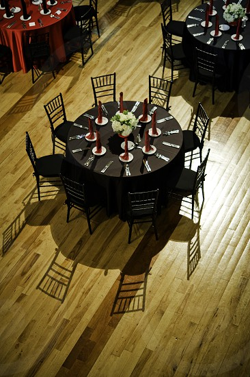 Reception hall set tables and a wooden floor photo