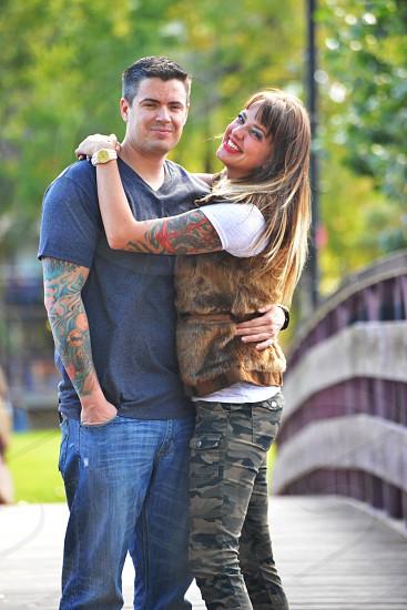 woman hugging a man at footbridge photo