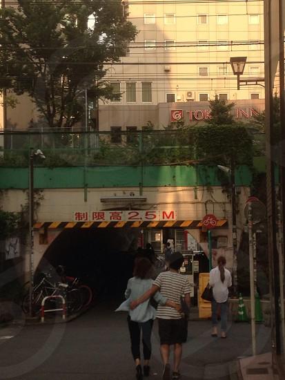 people walking towards tunnel photo