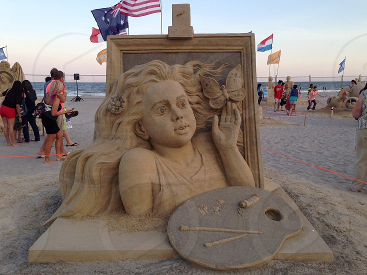woman bust statue on beach side photo