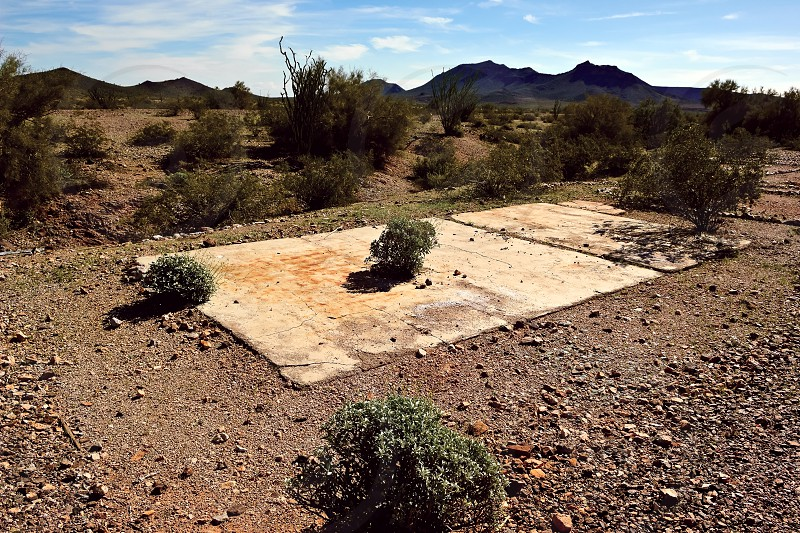 The remains of an old cement foundation in the ghost town of Sundad Arizona. Sundad began in the 1920s as a TB Sanitarium but when a viable treatment was discovered in the 1940s the Sanitarium was abandoned. Sundad lies within federal BLM land. photo