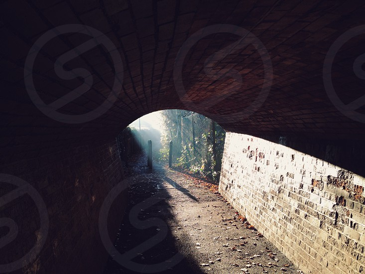 brown brick walled tunnel photo