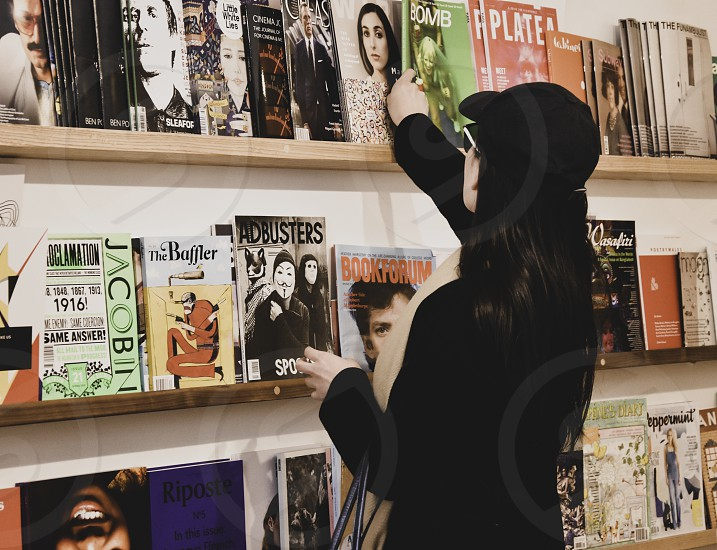 Woman browsing in a magazine shop. photo