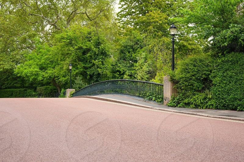 London UK. York bridge across Boating lake canal in Regent's Park in city centre. photo