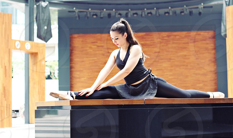 Ballet girl stretching in a split photo