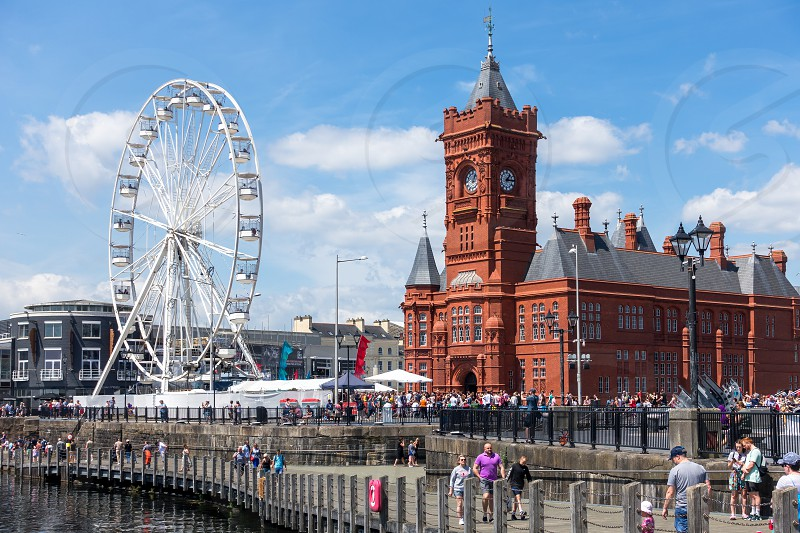 CARDIFF/UK - JULY 7 : View of the Ferris wheel and the Pierhead Building in Cardiff on July 7 2019. Unidentified people photo
