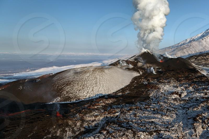 Beautiful Kamchatka landscape: view of sunrise on eruption Tolbachik Volcano (view from helicopter). Eurasia Russia Far East Kamchatka Peninsula Klyuchevskaya Group of Volcanoes. photo