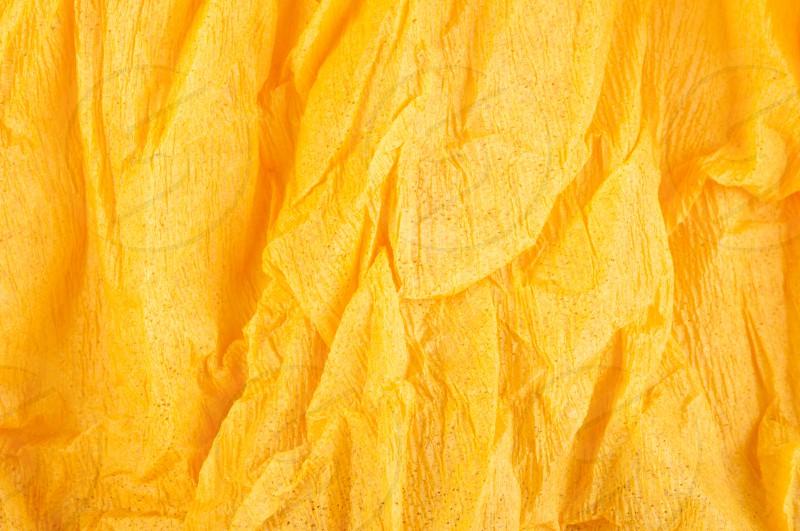 Background of orange old crumpled paper photo