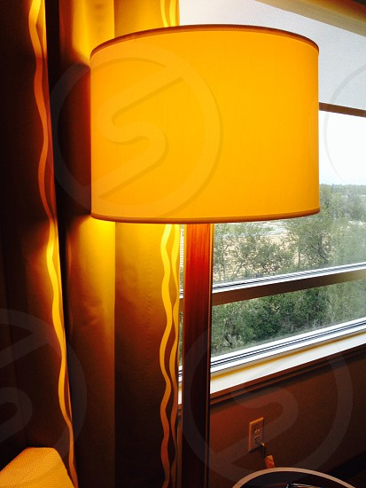 yellow buffet lamp near window photo