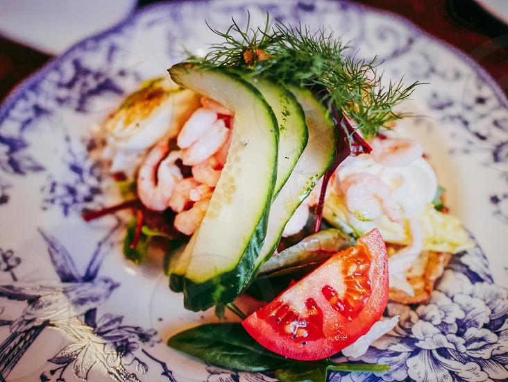 Cucumber  dill shrimps egg closeup salad shrimp salad  photo