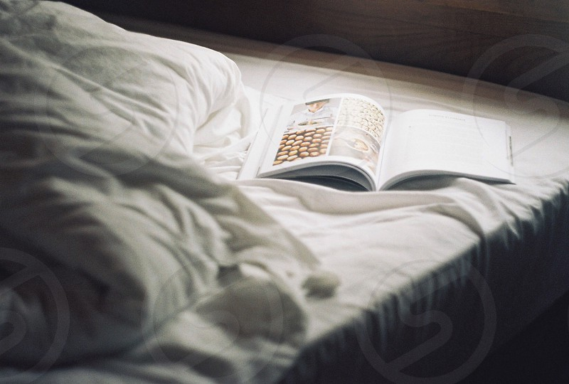 opened book on bed photo