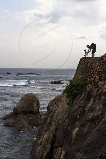 Photographer on the rock photo