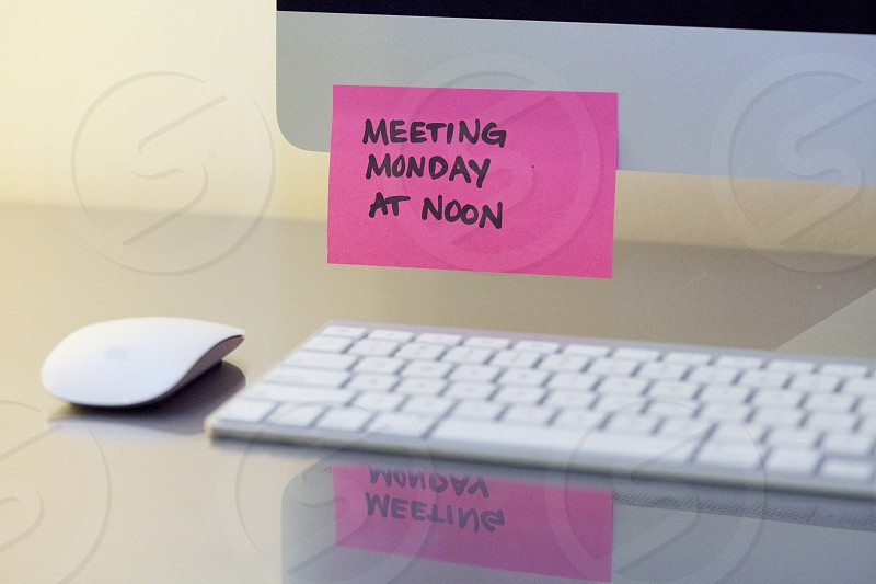 meeting monday at noon sticky  note on white computer photo
